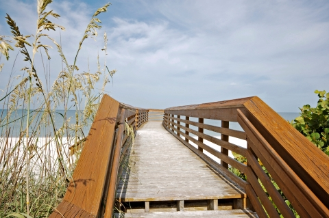 A boardwalk through mangrove forest leads to beautiful Clam Pass Beach Park.