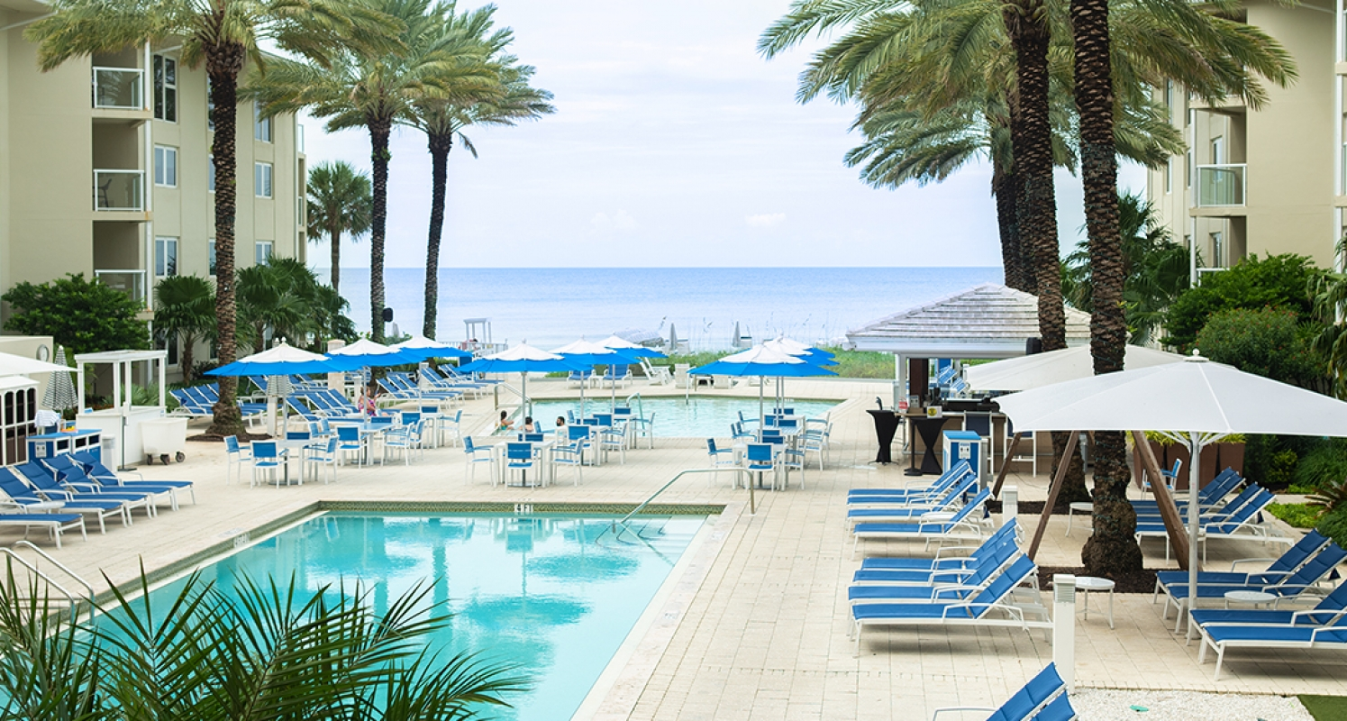 A Naples area resort pool overlooks the beach and the Gulf of Mexico
