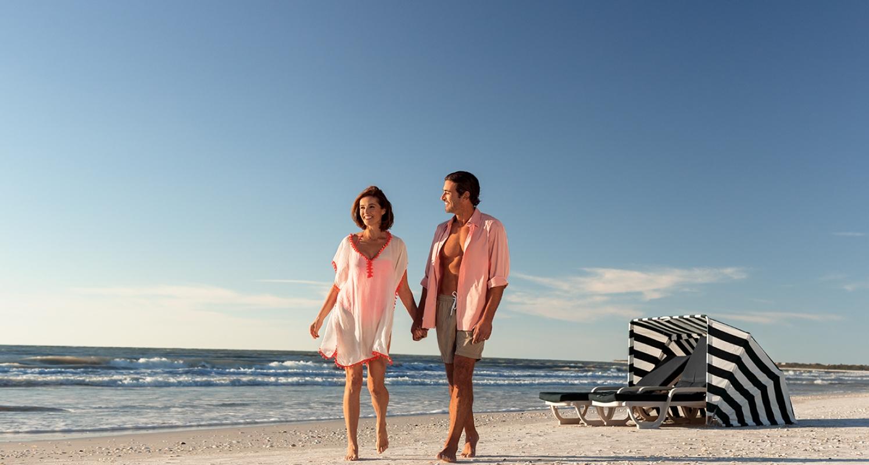 couple walking along the gulf