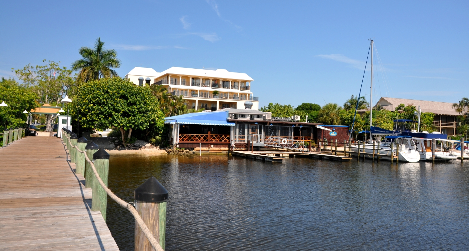 The Dock restaurant viewed from Naples City Dock.  Photo by JoNell Modys