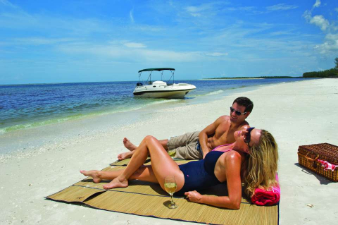 A couple spends time together on a secluded beach in the Naples and Marco Island area of Florida.