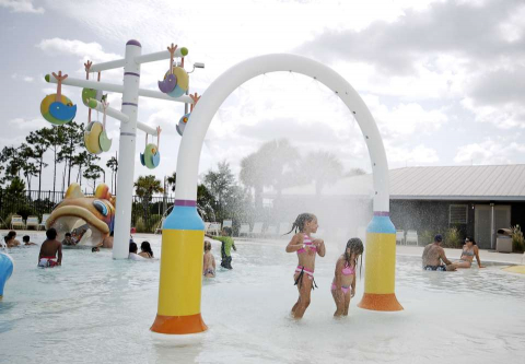 Kids enjoy the pool at Sun-N-Fun Lagoon water park in Naples, Florida