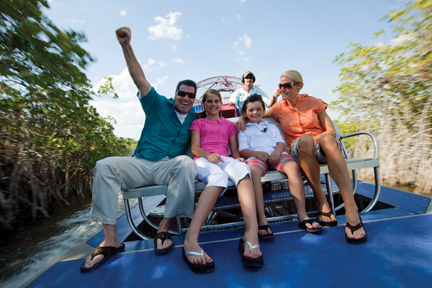 A family enjoys an exhilarating tour of the Florida Everglades on an airboat.