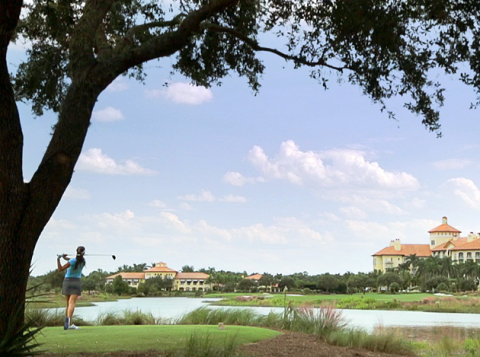 A woman plays golf at Tiburon Golf Club in Naples, Florida.