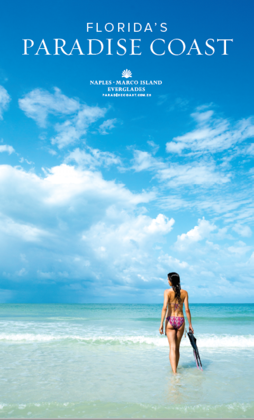 The cover photo of the Print Guide featuring a woman walking on the beach
