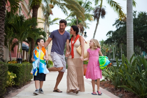 Enjoying a family stroll to the Beautiful Gulf Coast Beach on 5th Avenue South!