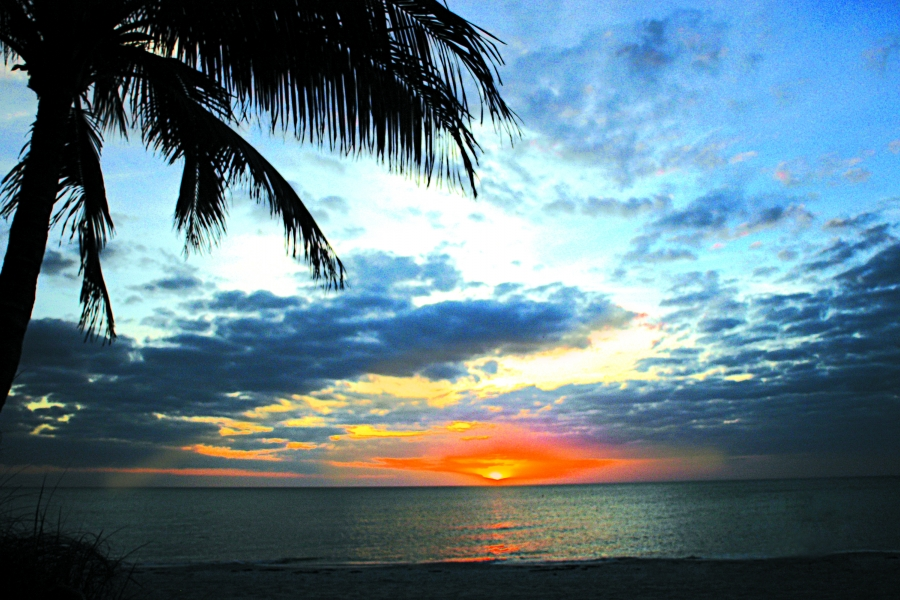Gulf coast sunsets over the beach in Naples and Marco Island lend tropical appeal to your getaway.  Photo by: Naples, Marco Island, Everglades CVB