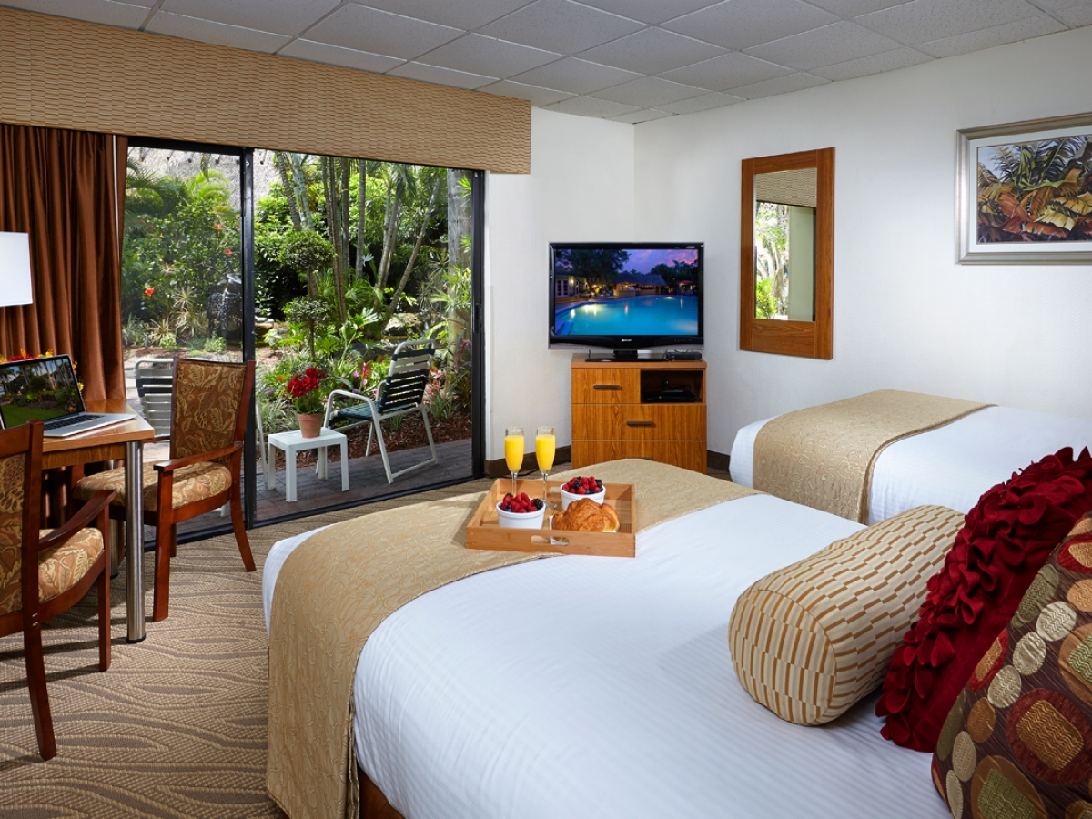 Standard Room with patio to our lush tropical landscape and Koi fish ponds.
