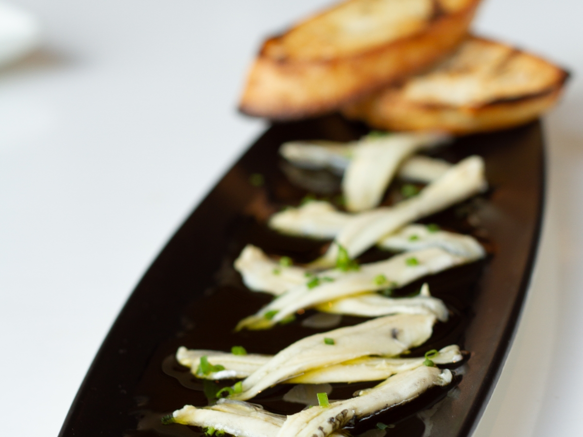 Boquerones. Imported marinated white anchovies served in olive oil & garlic bread