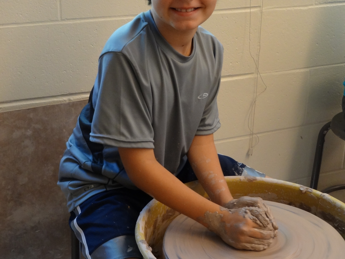 Young artists explore their creativity at the summer art education program called ARTScool.