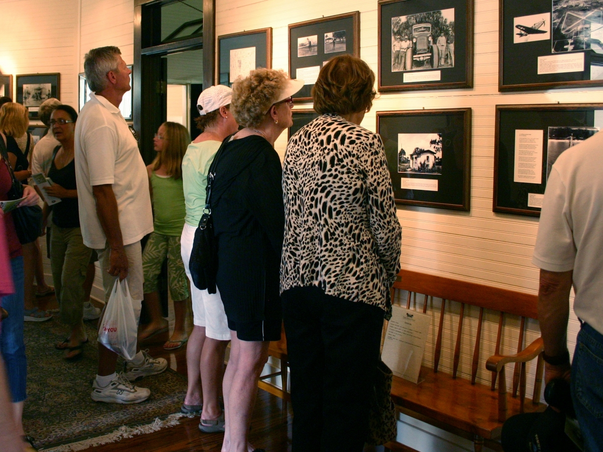 Visitors Viewing Archival Photos in Palm Cottage