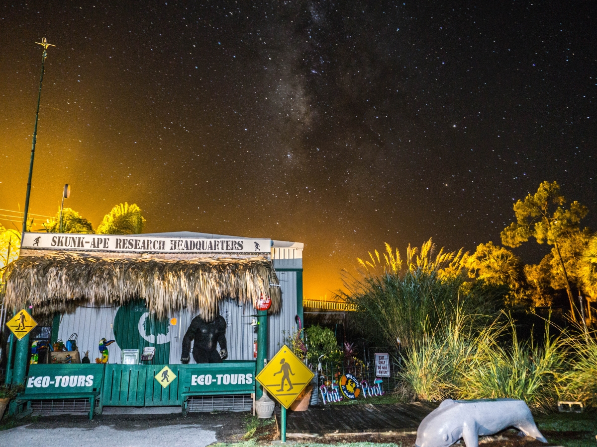 Night sky over Skunk Ape Headquarters shop at Trail Lakes Campground
