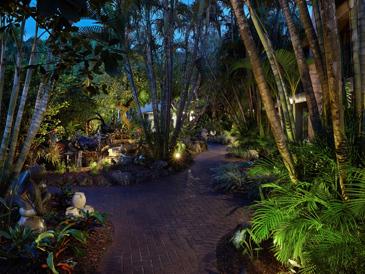 Tropical garden path and sculptures