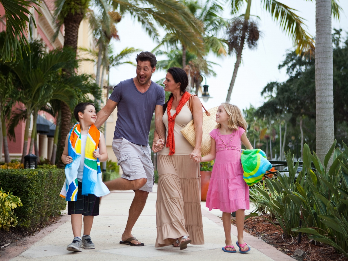 Enjoying a family stroll to the Beautiful Gulf Coast Beach on 5th Avenue South!