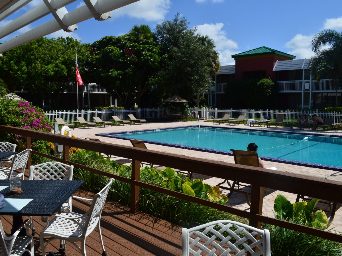 Outdoor Pool and Tropical Courtyard from Restaurant Deck