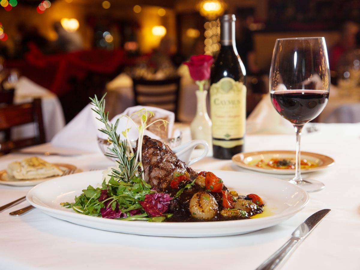 Pazzo!'s Grande Bistecca – a 16-ounce grilled ribeye with an espresso and brown sugar sugo, parmesan whipped potatoes and roasted cipollini onions!